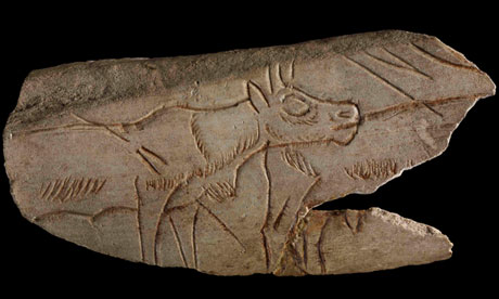 Fragment of decorated reindeer metatarsal